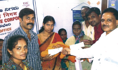 Handing over cheque payment of ESI Benefit.